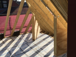 Timber gussets preventing spread of rafters in roof